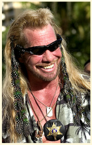 Dog the Bounty Hunter wearing guinea fowl and peacock feathers. Dog rocks!